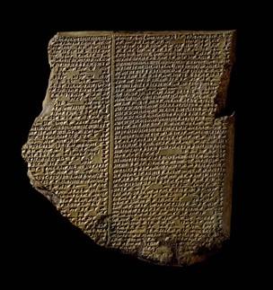 Broken clay tablet with cuneiform text